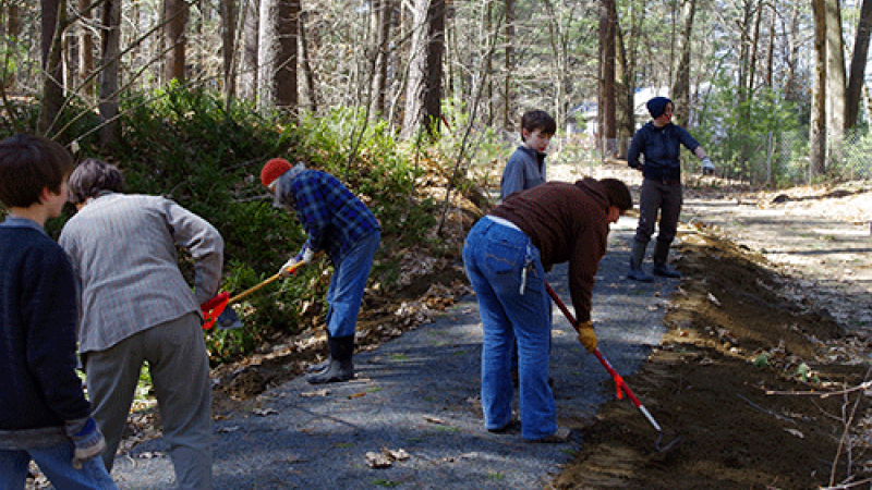 volunteers raking a trail
