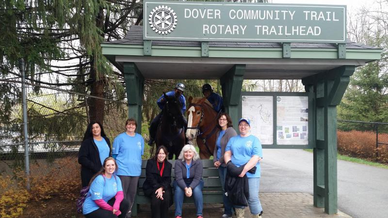 volunteers standing at Dover Community Trailhead