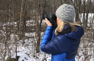 Person with camera in woods
