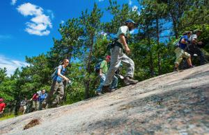 hikers walking on large boulder