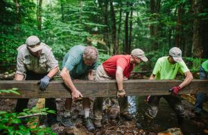 Volunteers building trail bridges