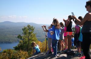 children on a mountain top looking at the view