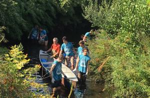 Volunteers on picking up trash along the river