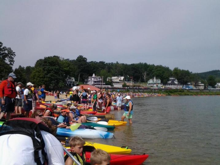 Canoes and kayaks lined the shore at Weirs Beach