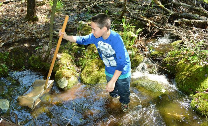 Student in water at Bioblitz