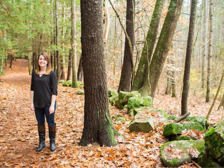 Holly Fosher standing in a forest