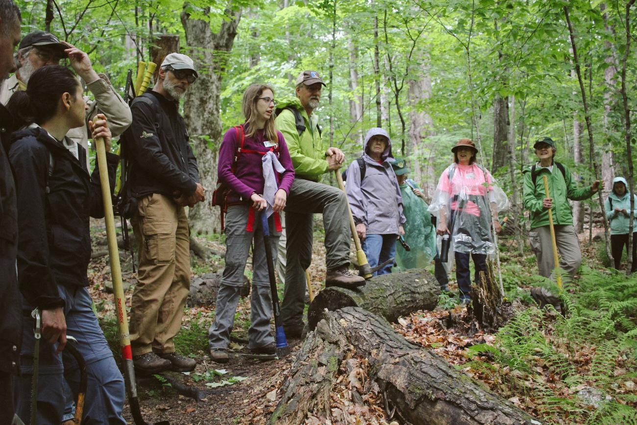 Emily Lord and Lew Shelley lead volunteers learning about trails