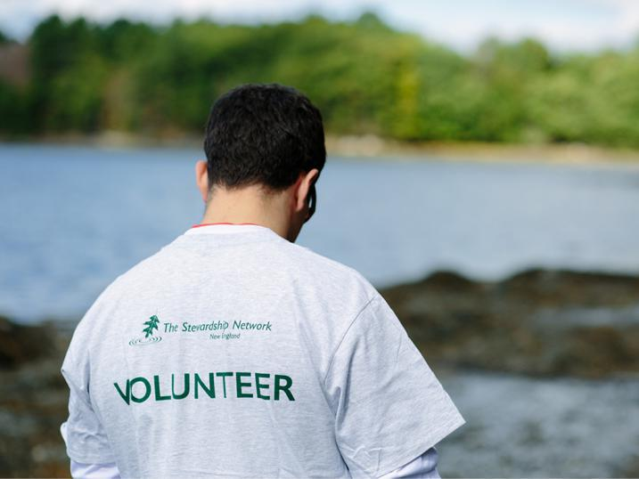 Volunteer shirt guy next to water