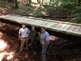 Jo Lewis and new bridge in College Woods